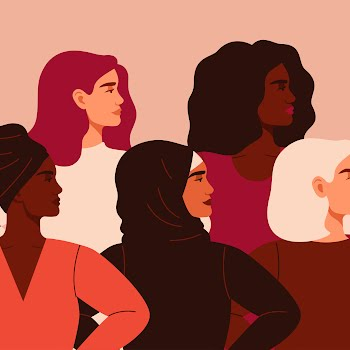 Five women of different nationalities and cultures standing together.