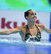"""Olympian swimmer """"disappointed"""" she had to leave breastfeeding son at home"""